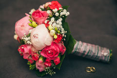 Flowers wedding bride hands. Rings Royalty Free Stock Photography
