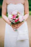 Flowers wedding bride hands. Rings Stock Photo