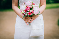 Flowers wedding bride hands. Rings Stock Photography