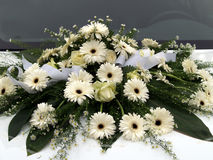 Flowers wedding car 1. Flowers on a white wedding car Royalty Free Stock Photos