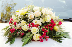 Flowers by the wedding car Royalty Free Stock Image