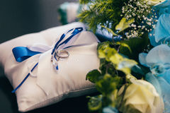 Flowers wedding decoration. Rings bride Stock Photo