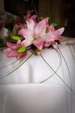 Flowers on a wedding dress Stock Photos