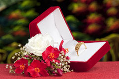 Flowers and wedding rings Stock Image