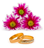 Flowers and wedding rings Stock Photography