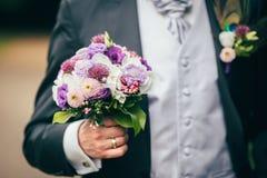 Flowers wedding rings groom Stock Image