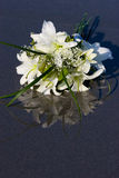 Flowers on the wet sand. Brides Bouquet of Flowers sitting in the wet sand Royalty Free Stock Photography