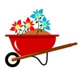 Flowers In Wheelbarrow. Flowers in a red wheelbarrow full of soil Stock Illustration