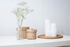 Flowers, white candles and two closed baskets Royalty Free Stock Images