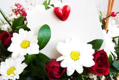 Flowers with a white card Stock Images