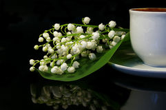 Flowers and white cup of black coffee stock photos
