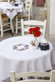 Flowers, white dining table Stock Image