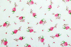 Flowers on white fabric pattern background Stock Images