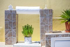 Flowers in white pots in cozy hotel in Santorini Royalty Free Stock Photo