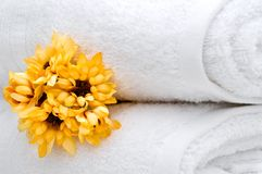 Flowers and white towels Royalty Free Stock Photography