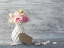 Flowers in a white vase. With tag for your text royalty free stock photos