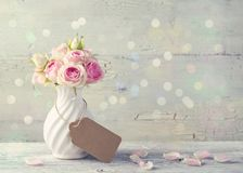 Flowers in a white vase. With tag for your text stock images
