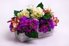 Flowers in a white wooden basket stock images
