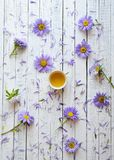 Flowers on white wooden table. stock image