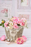 Flowers in wicker basket in vintage style interior Royalty Free Stock Photos