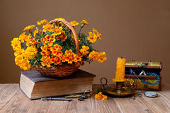 Flowers in wicker baskets, books and jewelry Stock Photo