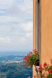 Flowers on the window against view of italian city Royalty Free Stock Photo