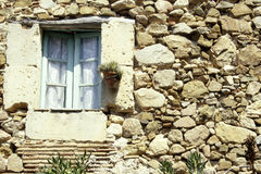 Flowers by the window. Flowers in the window on the wall of the village homes in Croatia Stock Photo