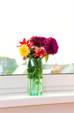 Flowers on windowsill Royalty Free Stock Photography