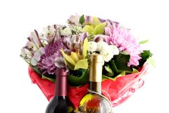Flowers and wine Stock Images