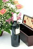 Flowers and wine Stock Image