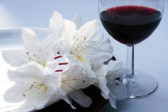 Flowers and wine. Dinner setting with exotic flowers and red wine Stock Photo