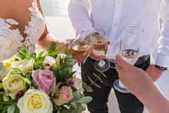 Flowers and wine glasses in the hands Royalty Free Stock Images