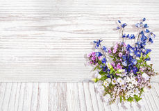 Flowers on wood texture background watercolor style Royalty Free Stock Image