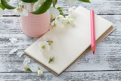 Flowers on wooden background with colour pencils Stock Images