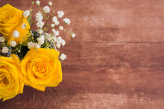 Flowers on wooden background Stock Images
