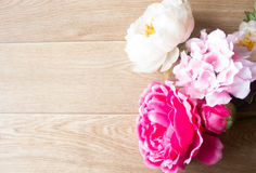 Flowers on wooden background. Large blooms on wooden background stock images