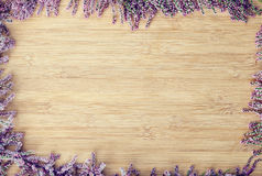 Flowers on wooden background Stock Photos