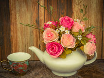 Flowers on wooden rusty background,vintage color tone. Royalty Free Stock Image