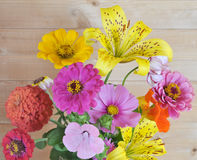 Flowers and wooden wall Stock Photos