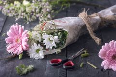 Flowers wrapped in newspaper stock photo