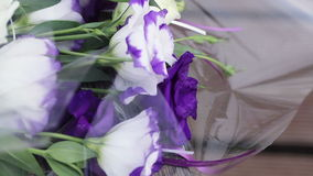 Flowers wrapped. Wedding flowers from guests in cellophane stock video footage