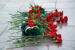 Flowers and a wreath at the memorial in memory of those killed in wars and armed conflicts. The memory of the victims of the war. Russia stock image