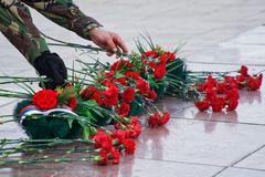 Flowers and a wreath in memory of those killed in wars and armed conflicts. The memory of the victims of the war. Russia royalty free stock photos