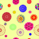Flowers on yellow background. Balls with colorful designs on the delicate yellow background Royalty Free Stock Image