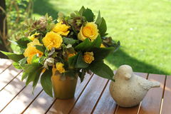 Flowers, yellow roses, garden. A beautiful bunch , with yellow roses, on a table, in the garden Stock Photo