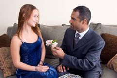 Flowers for you. Diverse couple with man offering teenager flowers royalty free stock photos
