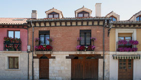 Flowers in your windows. Facades of several houses with flowers in your windows located in the Spanish city of Burgos Royalty Free Stock Photography