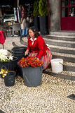 Flowerseller outside the Mercado dos Lavradores or the Market of the Workers Stock Photo
