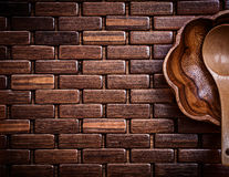 Flowershaped wooden bowl and spoon on wood matting copy space Stock Images