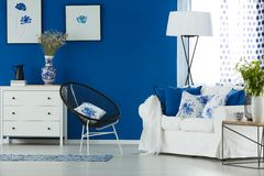 Flowery accessories in living room. Flowery accessories in blue and white living room royalty free stock image
